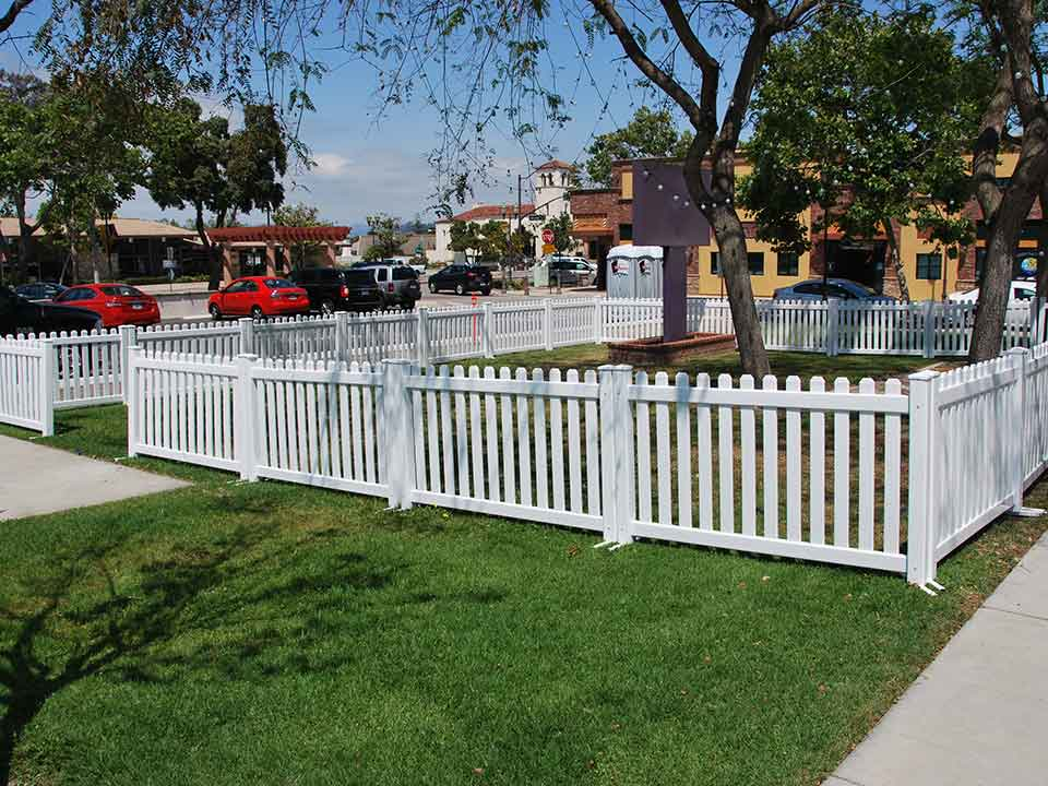 White fence Tall White Picket Fence Rental 01 Calstate Site Services Picket Fence Rental Service